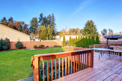 Large back yard with lots of grass and deck. Royalty Free Stock Photo