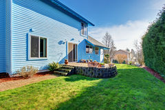 Large back yard with lots of grass. Stock Photography