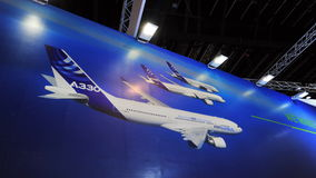 Large backdrop showing Airbus family of wide body passenger jets, the A330, A350 and A380 at Singapore Airshow Stock Photos