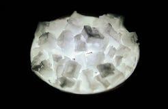 Large Backlit Salt Crystals. Large salt crystals backlit by a flashlight Royalty Free Stock Image