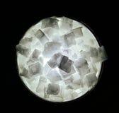 Large Backlit Salt Crystals. Large salt crystals backlit by a flashlight Royalty Free Stock Photo