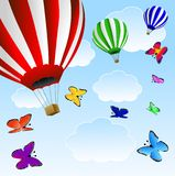 Large balloons and butterflie  in blue sky Royalty Free Stock Photos