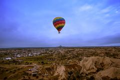 Large balloons fly over the mountains in Cappadocia. In Turkey. Flight in a balloon between Europe and Asia. Fulfillment of desires. Extreme. Colorful balloon stock images