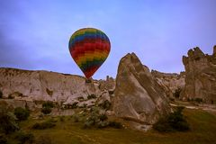Large balloons fly over the mountains in Cappadocia. In Turkey. Flight in a balloon between Europe and Asia. Fulfillment of desires. Extreme. Colorful balloon royalty free stock image