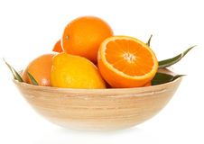 Large bamboo bowl with various citrus Stock Images