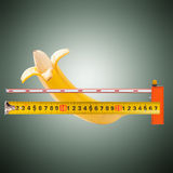 Large banana and measuring tape Royalty Free Stock Photography