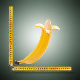 Large banana and measuring tape Royalty Free Stock Images