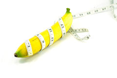 Large banana and measuring tape Royalty Free Stock Photos
