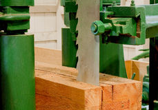 Large bandsaw cutting a timber Stock Photo