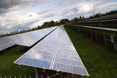 Large Bank Amorphous Solar Panels Green Energy. Solar energy is gaining popularity and a sun farm is shown here royalty free stock photos