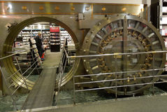 Large Bank Vault Door Opened in Bookstore. Peering through the large open bank vault door to the bookstore beyond royalty free stock images