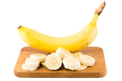 A large Bannana with cut slices Stock Image