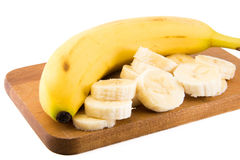 A large Bannana with cut slices Stock Photos