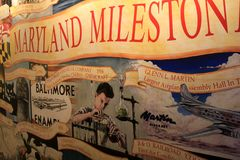 Large banner extoling virtues of Maryland`s inventions, Baltimore Industrial Museum, 2017. Intricate painting in large banner hanging on display, extoling the Stock Images