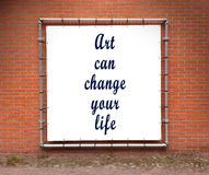 Large banner with inspirational quote on a brick wall Royalty Free Stock Images