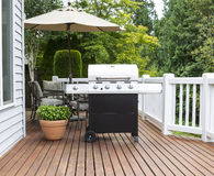 Large barbecue cooker on cedar deck Royalty Free Stock Photo