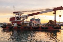 Large barge with a powerful crane in the port royalty free stock photo