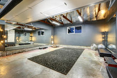 Large basement gym room with mirror Stock Images