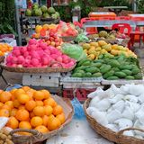 Large baskets with fruits, tropical fruits in the oriental bazaar stock images