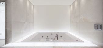 Large bath tub in the bathroom lit marble, nobody Stock Photography