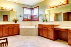 Large bathroom with double wood cabinets Stock Photos