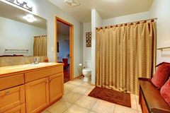 Large bathroom interior with bench. Stock Image