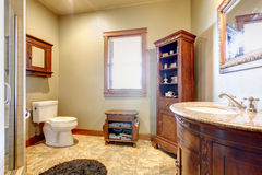 Large bathroom with wood furniture and natural colors. Royalty Free Stock Photos