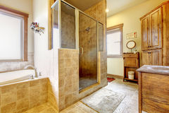Large bathroom with wood furniture and natural colors. Royalty Free Stock Image