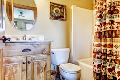 Large bathroom with wood furniture and natural colors. Royalty Free Stock Photography