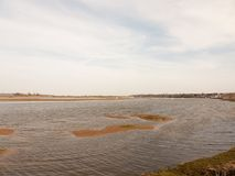 Large bay of water manningtree sky blue spring day coast. Essex; england; uk royalty free stock image