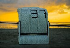 Large beach chair at sunset