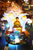 A large beautiful floats at Wesak Day Procession. Thousand Buddhist devotee parading with a beautiful floats at the Wesak Day procession along Petaling Street Stock Photo