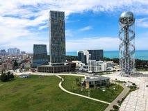 A beautiful metal tower alphabet and glass booms, buildings, skyscrapers on the coast. Batumi, Georgia, April 17, 2019 stock photo