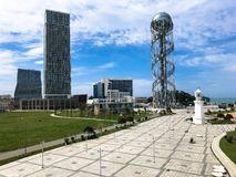 A beautiful metal tower alphabet and glass booms, buildings, skyscrapers on the coast. Batumi, Georgia, April 17, 2019 stock images