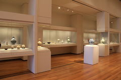 Large,beautiful room with glass cases filled with pottery,Cleveland Art Museum,Ohio,2016 Stock Photo