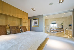 Large bedroom with en suite bathroom. Large luxury penthouse bedroom with en suite bathroom Royalty Free Stock Photo