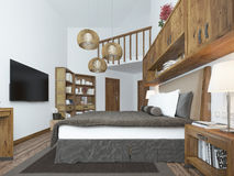 Large bedroom in modern style with elements of a rustic loft. Royalty Free Stock Image