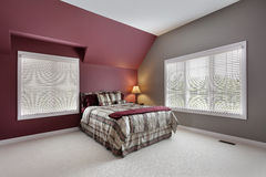 Large bedroom with multicolored walls Royalty Free Stock Photography