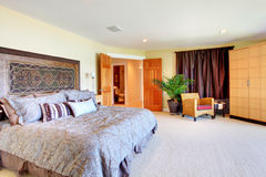 Large bedroom with open doors huge bed. Royalty Free Stock Photos