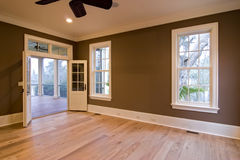 Large bedroom with porch. Large unfurnished bedroom or diningroom with open doors to porch Royalty Free Stock Photography