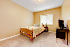 Large bedroom with yellow walls and beige carpet. Royalty Free Stock Images