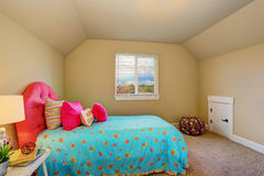 Large beige girl bedroom interior with pink bed Stock Photography