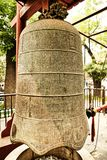 Large bell with carved Chinese characters in the Temple of the Great Bell. Beijing, China. royalty free stock photography