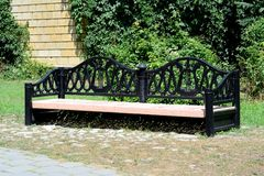 Large bench in the park. Royalty Free Stock Images