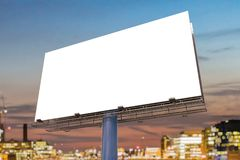 Large billboard against sky at sunset. 3D rendered illustration Royalty Free Stock Photos