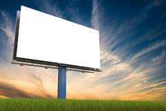 Large billboard against sky at sunset. 3D rendered illustration.  Royalty Free Stock Image