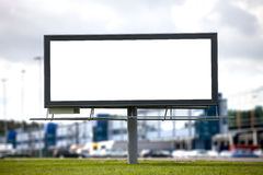 Large billboard. Blank Large billboard against blurred shopping center for your advertisement royalty free stock image