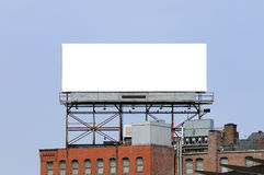 Large Billboard in the City. Bank commercial sign on roof of brick building. Large billboard in the city. Outdoor advertising with urban flavor Royalty Free Stock Photography