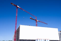 Large billboard and construction site Stock Images