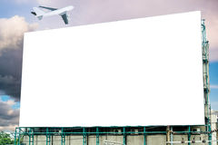 Large billboard white blank and airplane on sky stock images